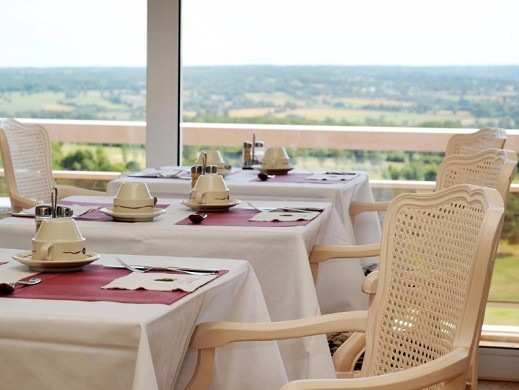 The dryades resort golf and spa - table overlooking the golf course