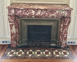 The period fireplace has been restored